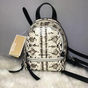 b41658c4794d Michael Kors Bags - 🔥NWT Michael Kors Rhea Snake-Embossed Backpack XS